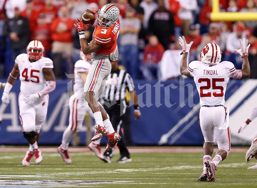 Ohio State Buckeyes wide receiver Michael Thomas (3) catches a pass during the Big Ten Championship game between the Ohio State Buckeyes and the Wisconsin Badgers at Lucas Oil Stadium in Indianapolis, Saturday night, December 6, 2014. The Ohio State Buckeyes defeated the Wisconsin Badgers 59 - 0. (The Columbus Dispatch / Eamon Queeney)