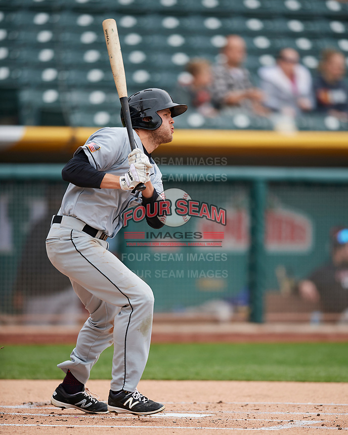 Nick Buss (11) of the El Paso Chihuahuas follows through with his swing against the Salt Lake Bees in Pacific Coast League action at Smith's Ballpark on April 30, 2017 in Salt Lake City, Utah.   El Paso defeated Salt Lake 12-3. This was Game 2 of a double-header originally scheduled on April 28, 2017.(Stephen Smith/Four Seam Images)