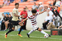 Houston, TX - Friday December 11, 2016: Amir Bashti (11) of the Stanford Cardinal keeps the ball from going out of bounds against the Wake Forest Demon Deacons at the NCAA Men's Soccer Finals at BBVA Compass Stadium in Houston Texas.