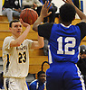 Kevin Voigt #23 of Massapequa, left, shoots from beyond the arc during a Nassau County Conference AA-1 varsity boys basketball game against Hempstead at Massapequa High School on Wednesday, Jan. 17, 2018. Massapequa won by a score of 50-44.