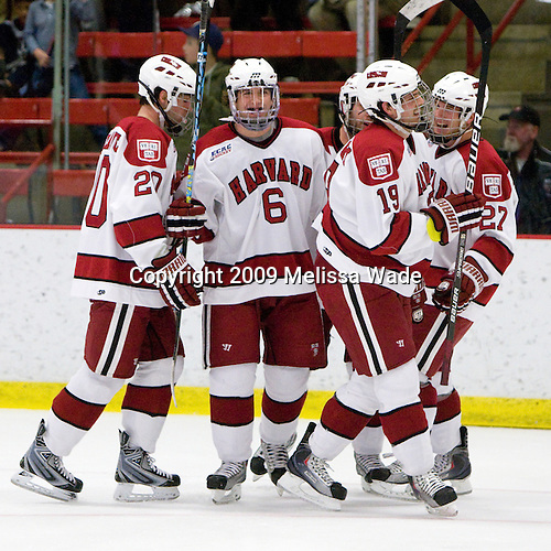 Louis Leblanc (Harvard - 20), Ryan Grimshaw (Harvard - 6), (Huxley), Alex Killorn (Harvard - 19), Michael Biega (Harvard - 27) - The Boston University Terriers defeated the Harvard University Crimson 6-5 in overtime on Tuesday, November 24, 2009, at Bright Hockey Center in Cambridge, Massachusetts.
