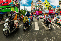 Two-wheeled traffic in Ho Chi Minh City (Saigon), Vietnam. There are over four million motorbikes in the city.