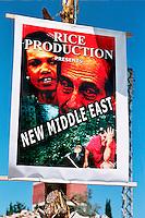 GANDOURIYE / SUD LIBANO  - SETT.2006.UN IRONICO MANIFESTO POSTO DAI GUERRIGLIERI HEZBOLLAH TRA LE MACERIE DEL VILLAGGIO DISTRUTTO DALLE TRUPPE ISRAELIANE DURANTE I 36 GIORNI DI GUERRA NELL'ESTATE 2006..FOTO LIVIO SENIGALLIESI..GANDOURIYE / SOUTH LEBANON - SEPT.2006.AN HIRONIC POSTER AGAINST UNITED STATES AND ISRAEL LEADERS AMONG THE RUINS OF HOUSES DESTROYED DURING ISRAELI AIR STRIKES IN SUMMER 2006..PHOTO LIVIO SENIGALLIESI