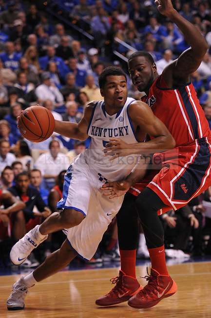 UK guard Andrew Harrison (5) dribbles to the basket during the first half of the UK men's basketball team vs Ole Miss at Rupp Arena in Lexington, Ky., on Tuesday, February 4, 2014.  Photo by Eleanor Hasken | Staff