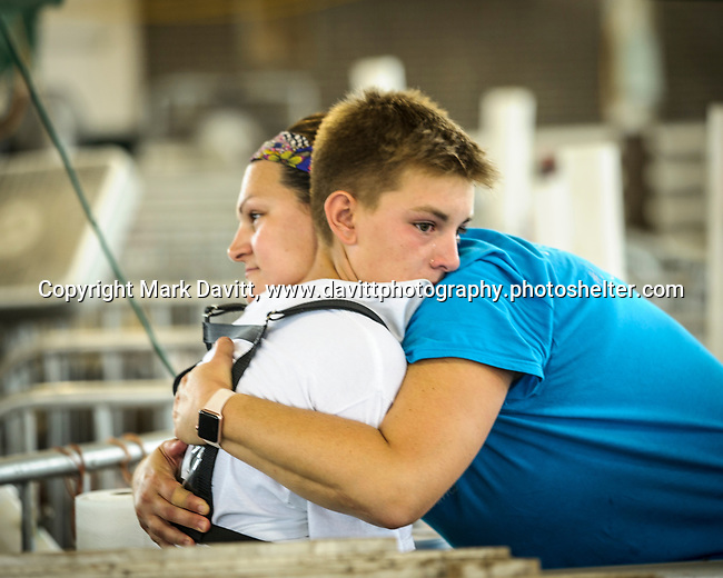Carter Sanny gets a hug from his mother, Stacia, after his entry did not place as high as he had hoped in the swine show at the Polk County Fair.