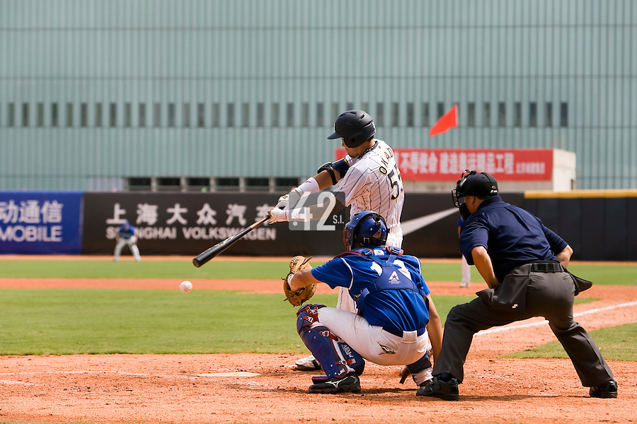 22 August 2007: Takahiro Okada hits the ball during the Japan 9-4 victory over France in the Good Luck Beijing International baseball tournament (olympic test event) at west Beijng's Wukesong Baseball Field in Beijing, China.