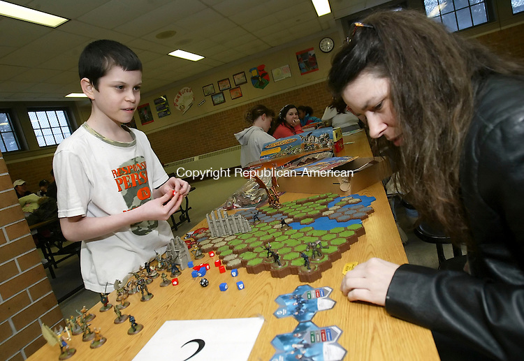 NAUGATUCK, CT, 03/21/07- 032107BZ04- Thomas Bendlin, 12, gr. 5, and his mother Tanya Bendlin, play Heroscape during a family literacy game night at Hop Brook School Wednesday.  The program is designed to help promote literacy by bringing families together to play board games.<br /> Jamison C. Bazinet Republican-American