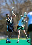 14 April 2010: Le Moyne College Dolphins' midfielder Rebekah Elmer, a Junior from Syracuse, NY, in action against the University of Vermont Catamounts at Moulton Winder Field in Burlington, Vermont. The Lady Cats defeated the visiting Dolphins 13-9. Mandatory Photo Credit: Ed Wolfstein Photo