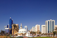 View of mosque and modern commercial and office buildings in Abu Dhabi city center/centre.   United Arab Emirates.