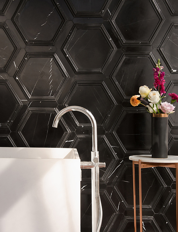 Coliseum, a stone waterjet mosaic, shown in honed Nero Marquina and Venetian honed Marquina, is part of the Altimetry® collection for New Ravenna.<br />