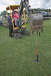 Child operating digger machine, Suffolk Smallholders annual show, Stonham Barns, Suffolk, England, July 2008
