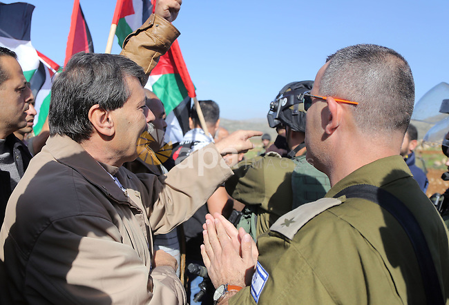 An Israeli border guard argues with Palestinian official Ziad Abu Ein (L), in charge of the issue of Israeli settlements for the Palestinian Authority, during a demonstration in the village of Turmus Aya near Ramallah, on December 10, 2014. Abu Ein died after being beaten by Israeli forces during a protest march in the West Bank, medical and security sources said. Photo by Shadi Hatem