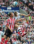 Sunderland's Danny Collins and Arsenal's Nicklas Bendtner. during the Premier League match at the Stadium of Light, Sunderland. Picture date 21st May 2008. Picture credit should read: Richard Lee/Sportimage