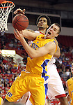 VERMILLION, SD - FEBRUARY 9: Allen Saint-Gelais #22 from the University of South Dakota battles for a rebound with Chad White #25 from South Dakota State in the second half of their game Thursday night at the DaktaDome in Vermillion, SD. (Photo by Dave Eggen/Inertia)