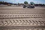 A grinding machine recycles the asphalt and concrete surface of the parking lot of Westerville Square Shopping Center to make way for the construction of a new WalMart store in the Columbus suburb. The store will approximately 108,000-square-feet, about half the  size of a traditional WalMart super store..