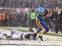 Philadelphia, PA - December 9, 2017:    Navy Midshipmen running back Malcolm Perry (10) breaks a tackle during the 118th game between Army vs Navy at Lincoln Financial Field in Philadelphia, PA. (Photo by Elliott Brown/Media Images International)