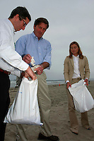 Lieutenant Governor John Garamendi (center), Dan Jacobson from environmental group Environment California and Angela Howe of Surfrider pick up trash in Ocean Beach at the base of Newport Avenue in Ocean Beach, Friday, July 25 2008.
