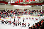 Wisconsin Badgers and the St. Cloud Huskies line up during the National Anthem prior to an NCAA women's college WCHA Conference playoff hockey game against the St. Cloud State Huskies Saturday, March 2, 2013, in Madison, Wis. The Badgers won 4-1. (Photo by David Stluka)