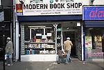 Muslim man and son shopping, Brick Lane, East End, London, England