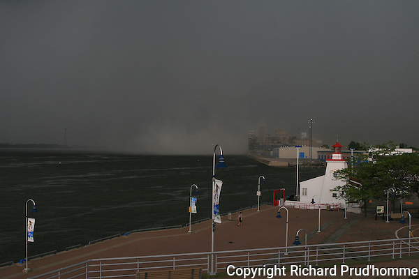 Heavy rain storm over the Saint-Laurence seaway making it's way to  the port of Trois-Rivieres