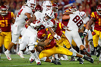 LOS ANGELES, CA - SEPTEMBER 8: Stanford Cardinal running back Dorian Maddox #28 is tackled by USC Trojans safety Talanoa Hufanga #15 during a game between USC and Stanford Football at Los Angeles Memorial Coliseum on September 7, 2019 in Los Angeles, California.