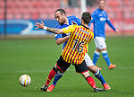 Partick Thistle v St Johnstone....25.10.14   SPFL<br /> Lee Croft is blocked by Jordan McMillan<br /> Picture by Graeme Hart.<br /> Copyright Perthshire Picture Agency<br /> Tel: 01738 623350  Mobile: 07990 594431