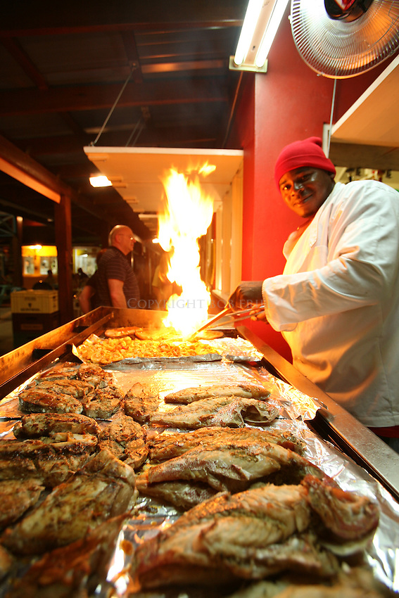 Grilling shrimp, red snapper, dolphin and other fish at Bellamy's Cocktail Bar & Grill.Oistin's Fish Fry.Oistin's, Christ Church Parish.Barbados.