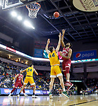 SIOUX FALLS, SD - MARCH 7: JaVonni Bickham #42 of the Denver Pioneers goes up for a jump shot Tyler Witz #44 of the North Dakota State Bison at the 2020 Summit League Basketball Championship in Sioux Falls, SD. (Photo by Richard Carlson/Inertia)