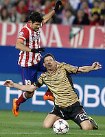 Atletico de Madrid's Diego Costa (l) and AC Milan's Daniele Bonera during Champions League 2013/2014 match.March 11,2014. (ALTERPHOTOS/Acero)