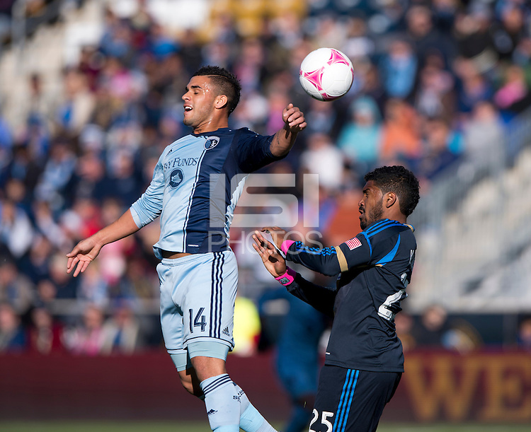 Dominic Dyer (14) of Sporting Kansas City is fouled on a header by Sheanon Williams (25) of the Philadelphia Union during a Major League Soccer game at PPL Park in Chester, PA. Sporting Kansas City defeated the Philadelphia Union, 2-1.
