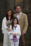 Confirmation in Donore Church...Photo: Fran Caffrey/www.newsfile.ie...Kirstie Coombes and parents Samantha and Shane