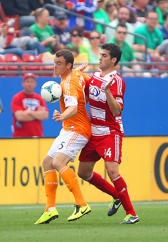 Frisco, TX - MARCH 17: George John #14 of FC Dallas challenges Cam Weaver #15 of Houston Dynamo at FC Dallas Stadium March 17, 2013 in Frisco, Texas. (©2013 Rick Yeatts)