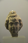 A clay female head, 1st century BC, found at the Temple Mount excavations, Jerusalem, on display at the Hecht Museum, the University of Haifa