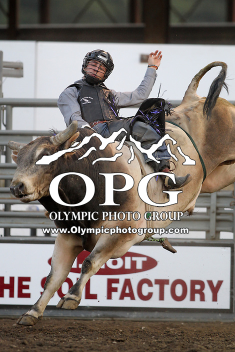 20 Aug 2014: Sage Steele Kimzey riding the bull Rackaholic scored a 79 during the second round of the Seminole Hard Rock Extreme Bulls competition at the Kitsap County Stampede in Bremerton, Washington. Sage Steele Kimzey was the 2014 winner with a combined score of 164.50.