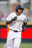 Engel Beltre (7) of the Charlotte Knights rounds the bases after hitting a home run against the Norfolk Tides at BB&T BallPark on April 9, 2015 in Charlotte, North Carolina.  The Knights defeated the Tides 6-3.   (Brian Westerholt/Four Seam Images)