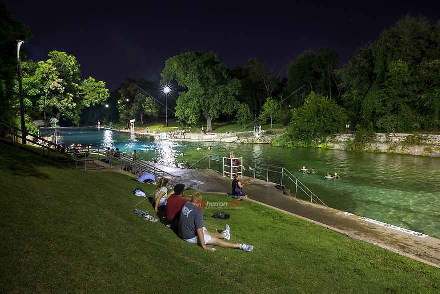 Baron Springs Pool is a beloved spring-fed pool maintaining a 68ºF temperature year-round with lifeguards on duty and open for late night swimming until 10 p.m.