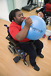 Woman exercising with Swiss ball at the gym. MR