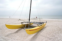 Catamaran on the white sand beach of the Gulf of Mexico.  North Redington Beach Tampa Bay Area Florida USA