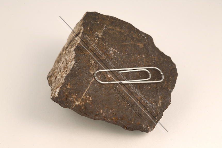 Magnetite. Magnetite, also known as lodestone, is a name given to either iron (III) oxide or iron (II) oxide. It is a naturally magnetic mineral. A sample of magnetite attracts an iron paper clip.