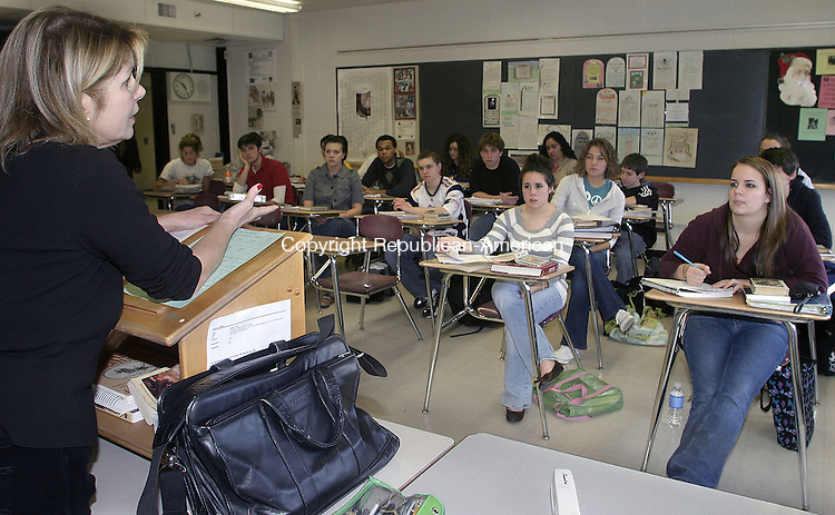 TORRINGTON, CT -07 DECEMBER 2007 -121207DA02-Students of Torrington High School listen to a lesson in Beth Roscoe's senior class Wednesday. A growing number of students at the school are taking the Advanced Placement classes, which you can take tests at the end of for possible college credit. This coincides with a growing number pursuing college. But as more students take the tests, more fail. This is OK, according to Torrington educators. It's better to have them at least exposed to college-level work than not at all.<br /> Darlene Douty/Republican-American