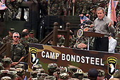 United States President George W. Bush speaks to U.S. soldiers and troops from other NATO nations at Camp Bondsteel in Kosovo on July 24, 2001.  Bush is visiting the Task Force Falcon soldiers to show support for the troops in Kosovo.  The president signed the fiscal year 2001 Emergency Supplemental Appropriations legislation which contains $1.9 billion for military pay, benefits and health care among other categories during his visit.  <br /> Mandatory Credit: Clinton J. Evans / U.S. Army via CNP