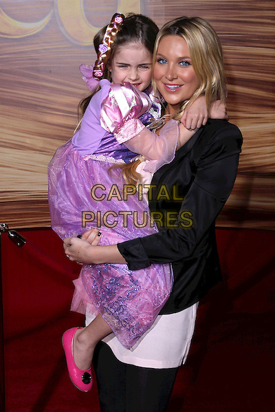 "STEPHANIE PRATT (R) & GUEST .""Tangled"" Los Angeles Premiere held at the El Capitan Theatre, Hollywood, California, USA, 14th November 2010..half length purple dress holding black jacket .CAP/ADM/CH.©Charles Harris/AdMedia/Capital Pictures"