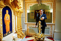 UNITED KINGDOM, London : British Prime minister David Cameron participate in a Abhishek ceremony in the deity room at the Neasden Temple on May 2, 2015 in London, England