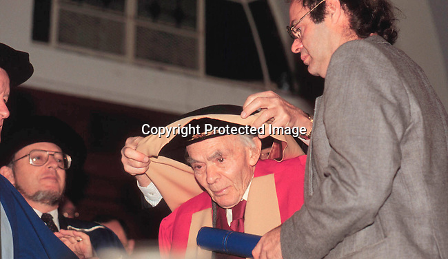 dipesim00006.Personality. Late Jack Simons (SACP/ANC) receiving an honoury doctorate from the University of Cape Town ..(Jack Simons, Ray Alexanders husband...main educator ANC Struggle years) Johan Simons his son on the right..©Sue Kramer/iAfrika Photos.