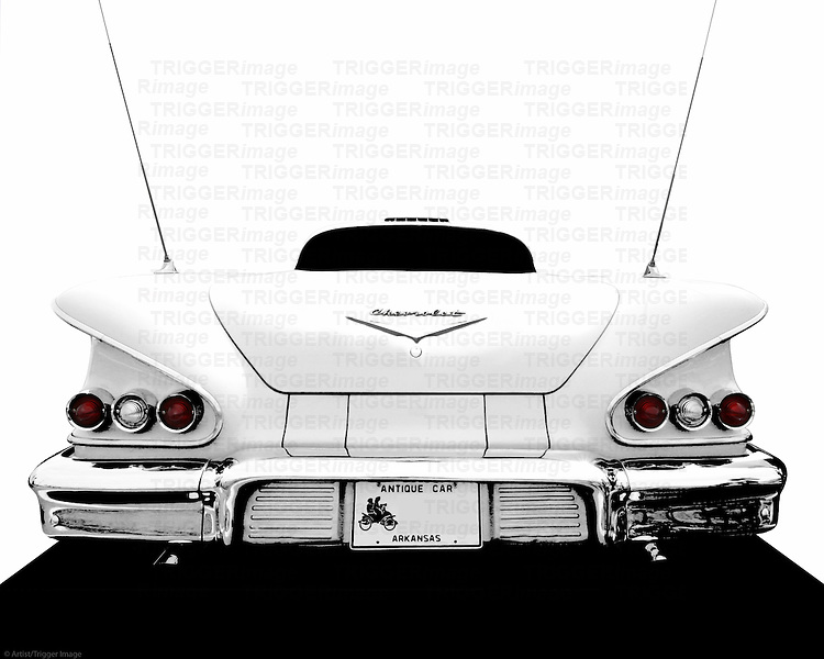 An iconic rear end from a classic cruiser.  The late 1950's were a strange era of design for the big 3 auto makers in America.  It was a time of excess, chrome, overdesign... shiny bits were added for extra sizzle.  Some think that the 1958 Impala was one of the best looking cars from this era.