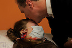 William Massart  kisses his daughter Sandra Massart, 10, at Duke University Hospital in Durham, NC, USA, on Tuesday, Feb. 14, 2012.  Sandra Massart is being treated for MLD, a degenerative condition.  Photo by Ted Richardson