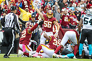 Landover, MD - October 14, 2018: Washington Redskins linebacker Zach Vigil (56) celebrates the recover the ball during the  game between Carolina Panthers and Washington Redskins at FedEx Field in Landover, MD.   (Photo by Elliott Brown/Media Images International)