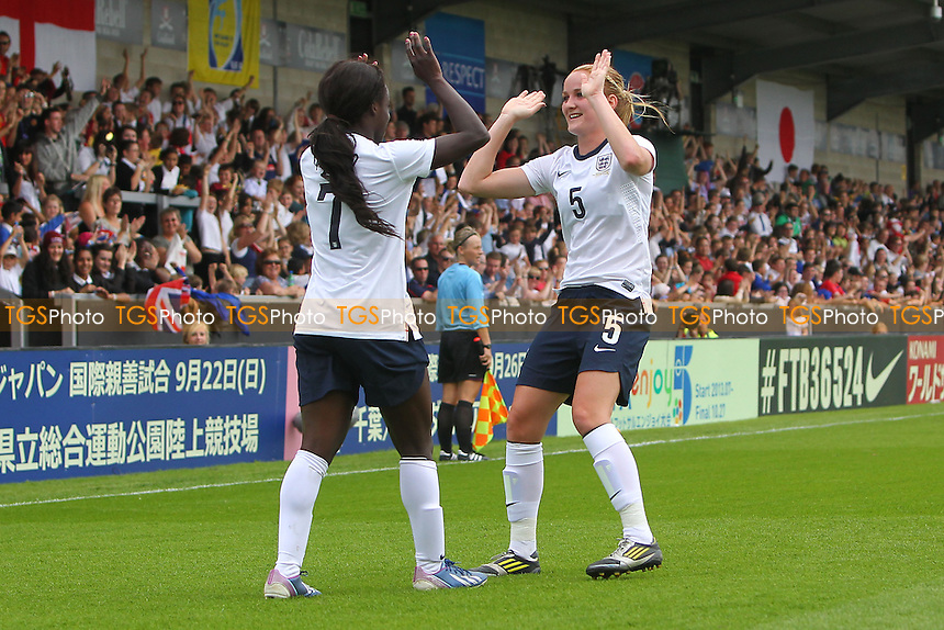 Eniola Aluko scores the first goal for England and celebrates with Sophie Bradley - England Women vs Japan Women - Friendly Football International at the Pirelli Stadium, Burton Albion FC - 26/06/13 - MANDATORY CREDIT: Gavin Ellis/TGSPHOTO - Self billing applies where appropriate - 0845 094 6026 - contact@tgsphoto.co.uk - NO UNPAID USE