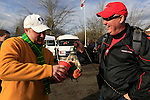 12/04/10-- Alex Casebeer of Northwest Portland gives his fellow Duck a refreshment after being drug around by Gene Mildren of Lake Oswego before the Civil War game at Reser Stadium in Corvallis, Or..Photo by Jaime Valdez......