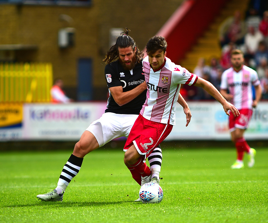 `Lincoln City's Michael Bostwick vies for possession with Stevenage&rsquo;s Jonathan Smith<br /> <br /> Photographer Andrew Vaughan/CameraSport<br /> <br /> The EFL Sky Bet League Two - Stevenage v Lincoln City - Saturday 9th September 2017 - The Lamex Stadium - Stevenage<br /> <br /> World Copyright &copy; 2017 CameraSport. All rights reserved. 43 Linden Ave. Countesthorpe. Leicester. England. LE8 5PG - Tel: +44 (0) 116 277 4147 - admin@camerasport.com - www.camerasport.com